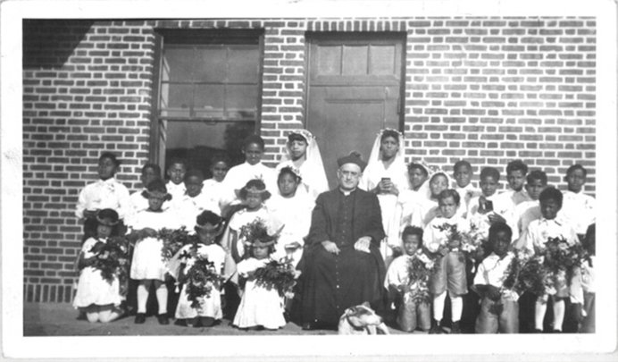Fr. Quinn with the orphan children at Wading River L.I.